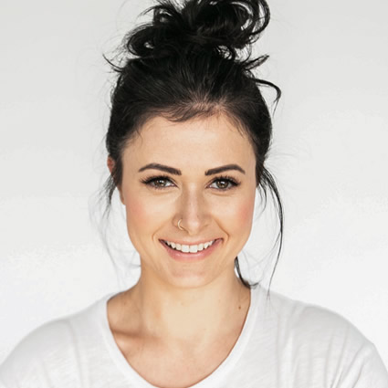 woman smiling nose pierced hair knot