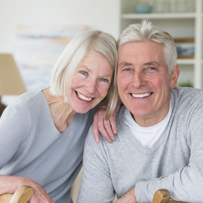 Old couple smiling perfect teeth