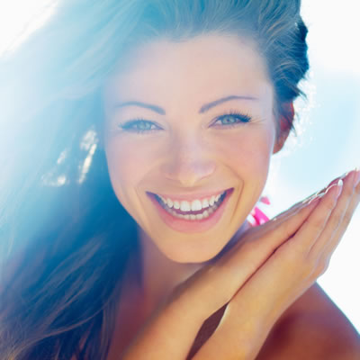 Woman smiling against light