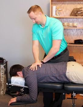 Dr. Jon adjusting a patient.