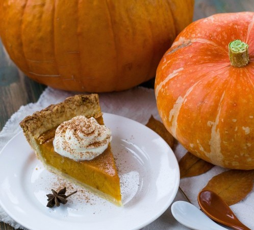 pumpkin pie and pumpkins on a table