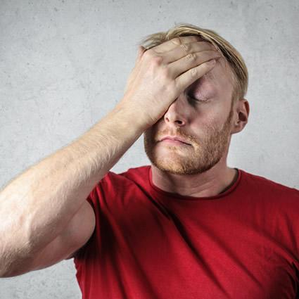 man red shirt with headache