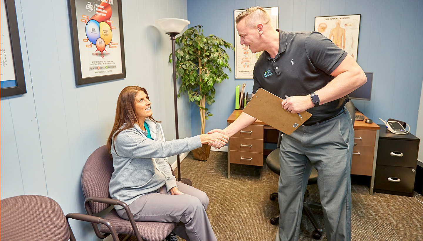 Dr. Trenary shaking hands with patient
