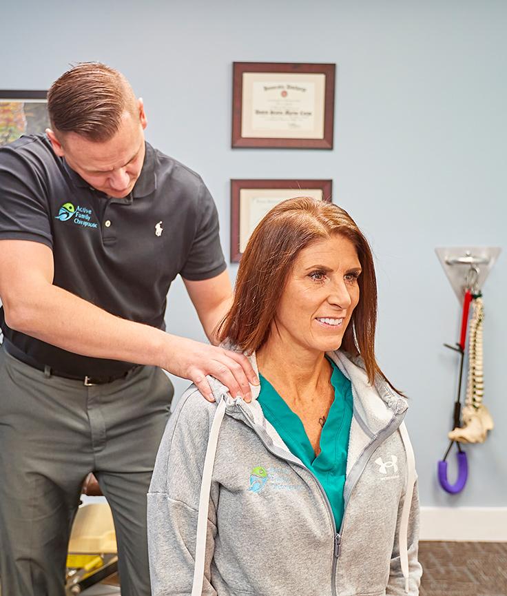 Dr. Trenary adjusting patient