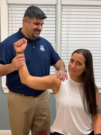 Dr. Grossman stretching patient arm