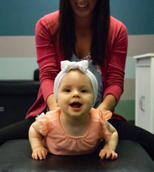 Infant receiving an adjustment