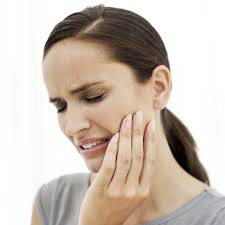 Woman suffering from TMJ pain.
