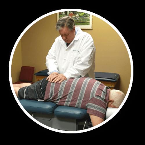 Dr. adjusting patient