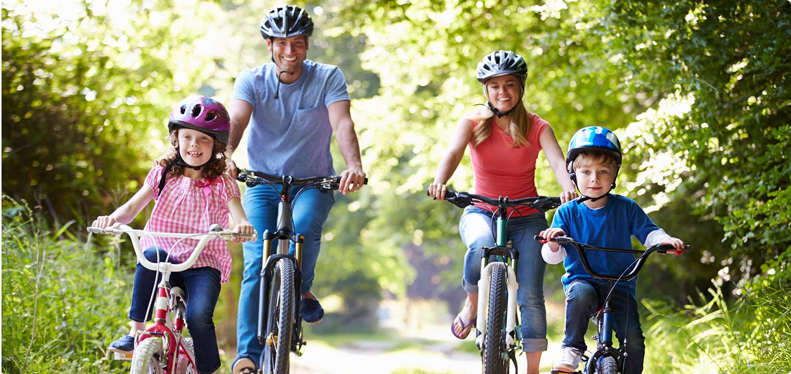 Family of four biking
