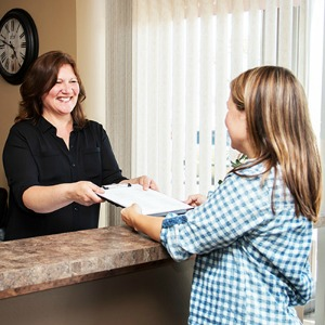 handing patient paperwork