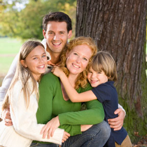 family-hugging-by-tree-sq-300