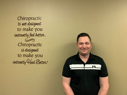Dr. Tim with quote on wall