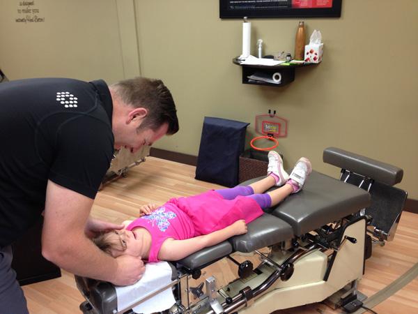 Dr. Tim Wood adjusts a paediatric patient
