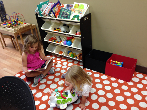 Children playing in {PRACTICE NAME} waiting area