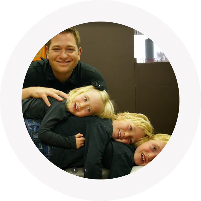 Dr. Wood with kids laying down