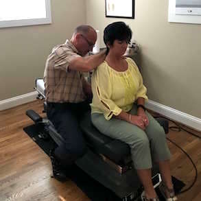 Bristol Chiropractor Todd Cooper performs an assessment on a patient