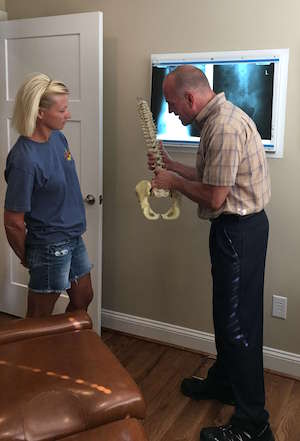 Bristol Chiropractor Dr. Todd Cooper provides an explanation to a patient