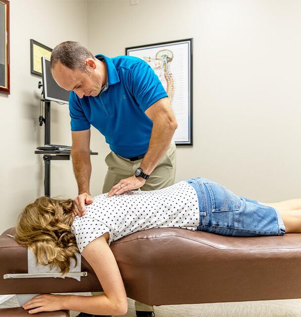 Dr Good adjusting girls back