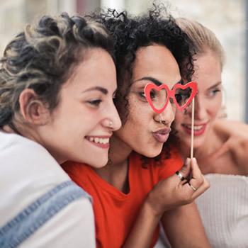 Young women having fun smiling groufie