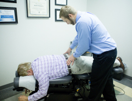 {PJ} chiropractor, Dr. Mark Johnson adjusting a patient