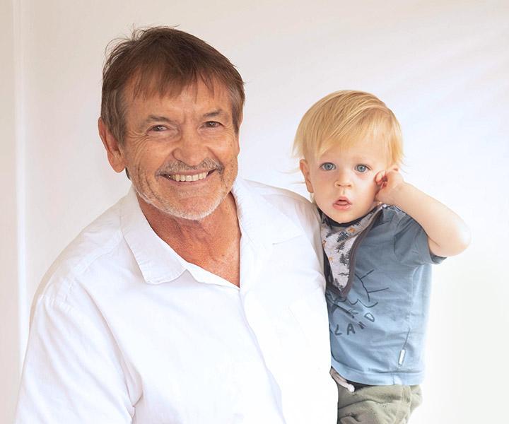 Doctor holding little boy