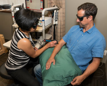 Laser therapy treatment on patient