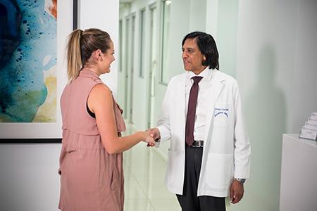 Dentist shaking womans hand