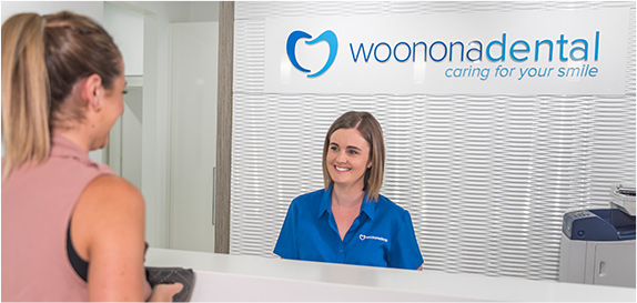 Woman standing at reception desk