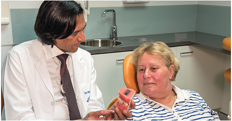Dentist consult with patient