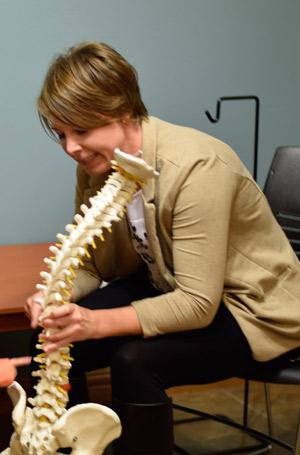 Chiropractor explaining spine model