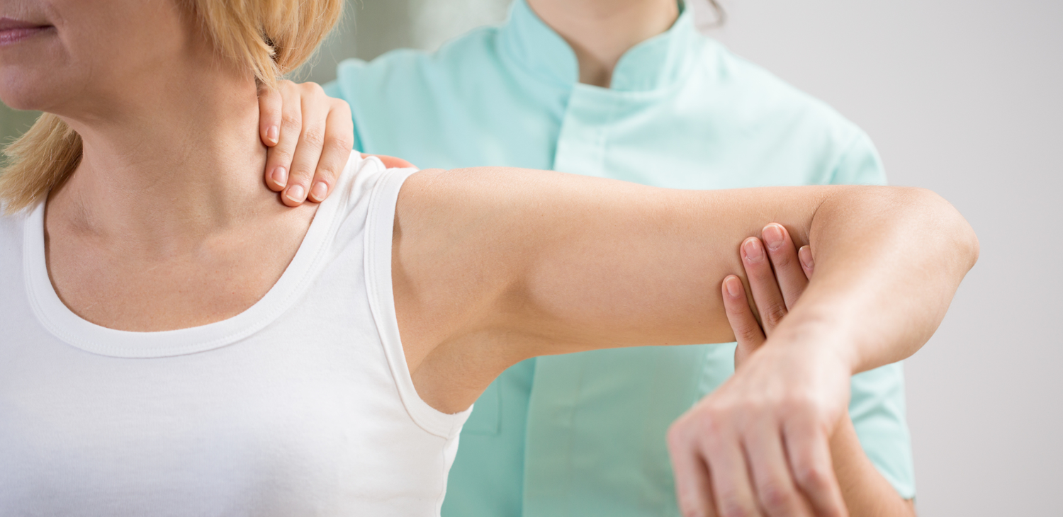 Doctor with hands on patients neck