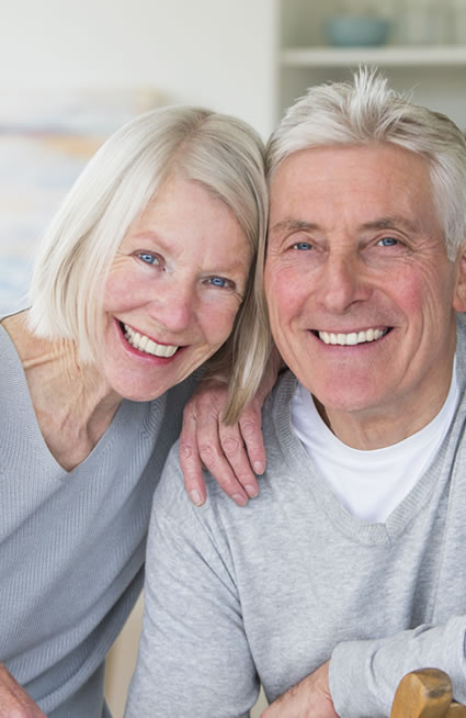 Mature couple smiling with nice white teeth