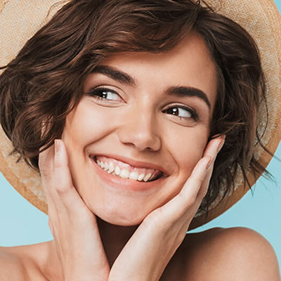 Woman smiling hands on face