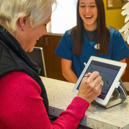 Patient signing paperwork