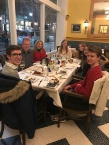 group of people eating dinner in restaurant