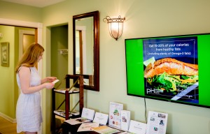 woman reading flyer about real salmon