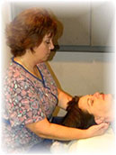 Photo of a Massage therapist at working on a client
