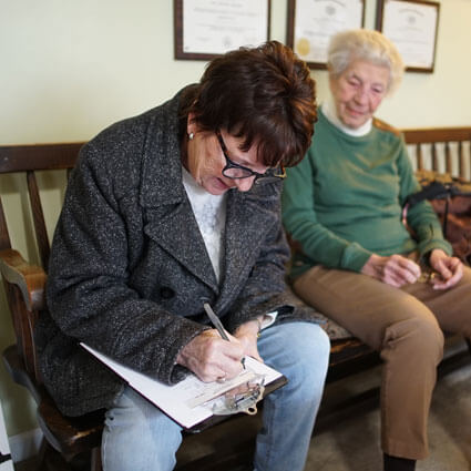 Patient filling out paperwork