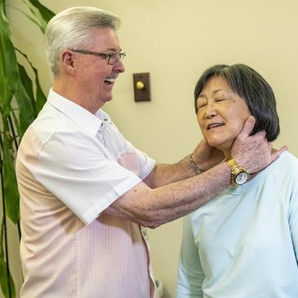 Dr. Shows adjusting womans neck