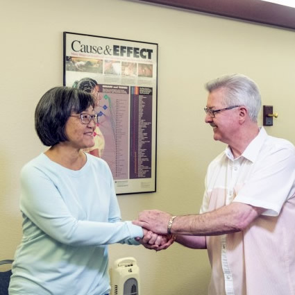 Dr Michael shaking hands