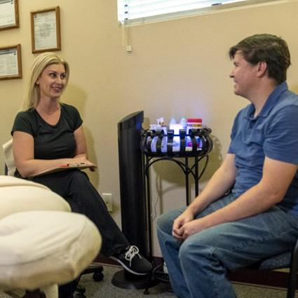 Massage Therapist talking to patient