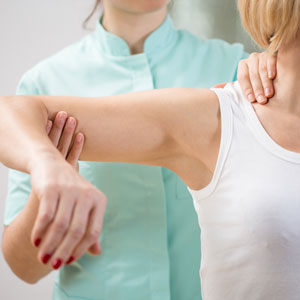 woman being treated for shoulder pain