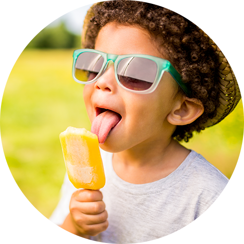 Child licking popsicle