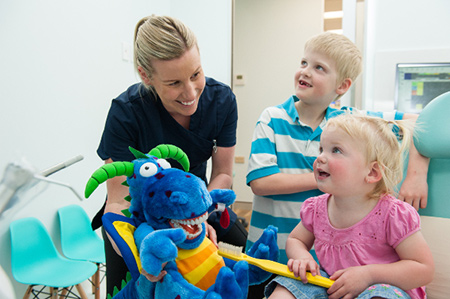 Oral Health Therapist and children in waiting room