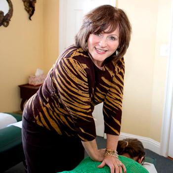 Chiropractor Marietta Dr. Debby Porter giving chiropractic adjustment.