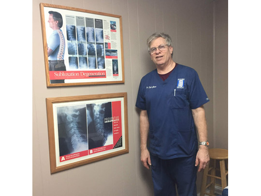 Dr. in front of spine images