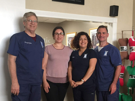 Four chiropractic team members