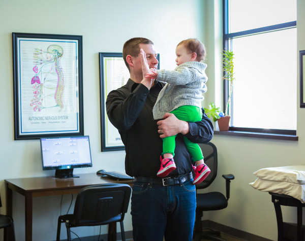 high five with Chiropractor Kennewick