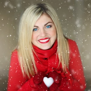 woman in red coat with snow