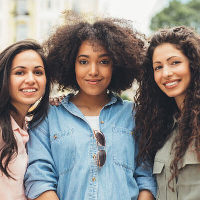 young women standing in a group smiling